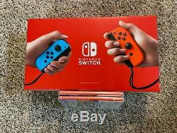 Nintendo Switch Console with Red and Blue JoyCon BRAND NEW + 2 GAMES (Sealed)